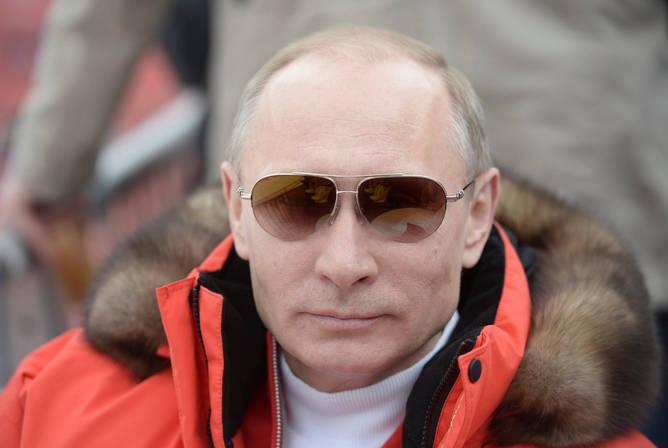 Merasa demam? Putin mengenakan pakaian tebal. (REUTERS/Alexei Nikolskiy/RIA Novosti/Kremlin)